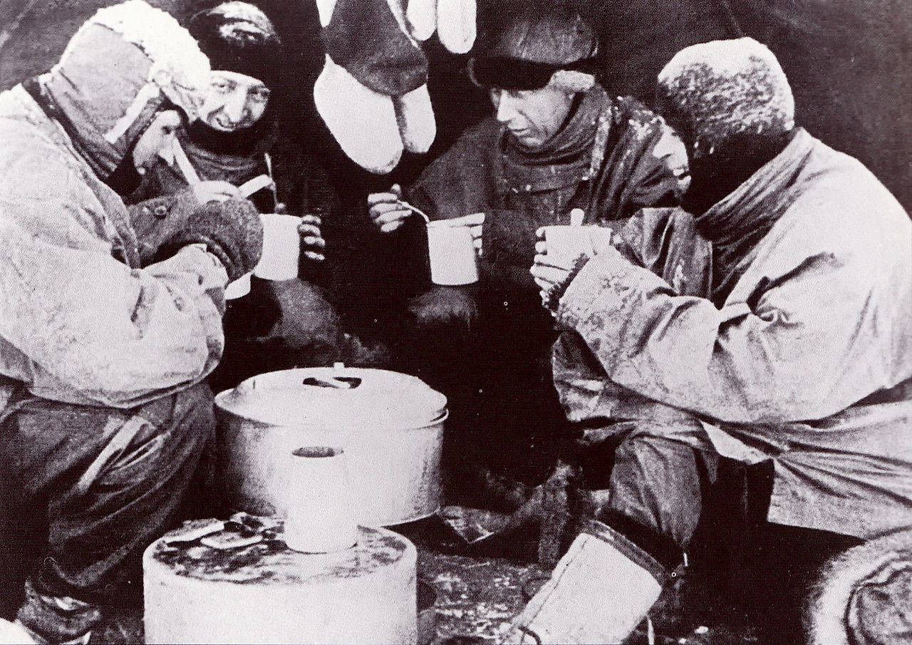 Mealtime during the Terra Nova Expedition. From left to right - Evans, Bowers, Wilson and Scott