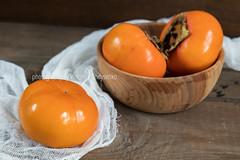 Fresh persimmons fruit in bowl